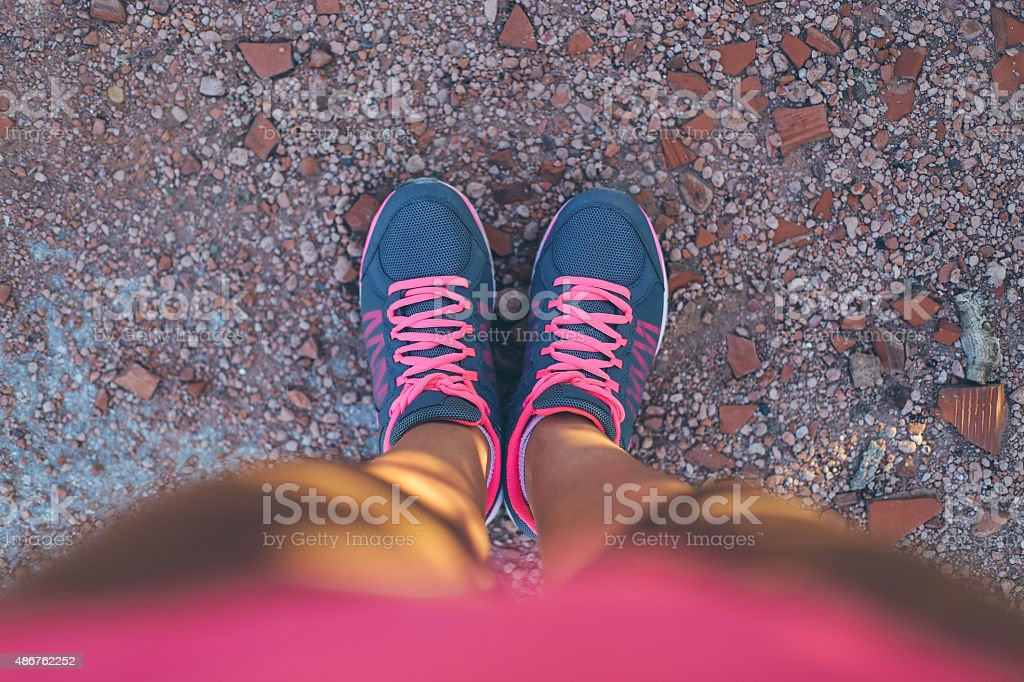 I look at my running shoes stock photo