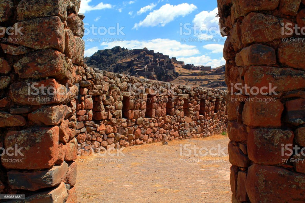 look between a wall at the ruins terraces of pisac stock photo