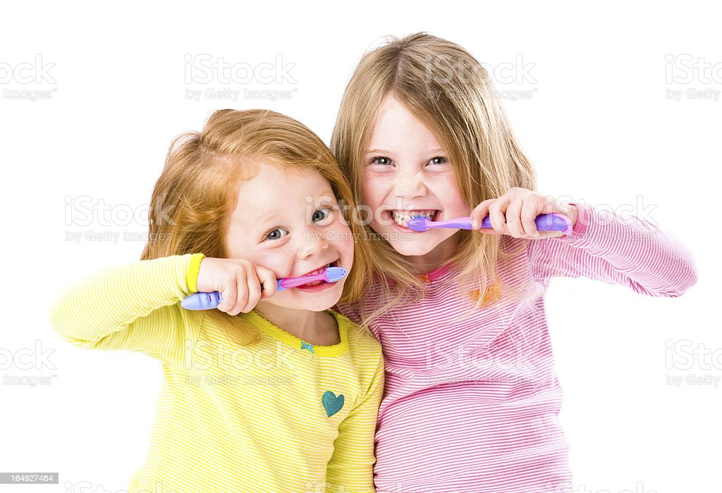 Look dad we are brushing our teeth stock photo