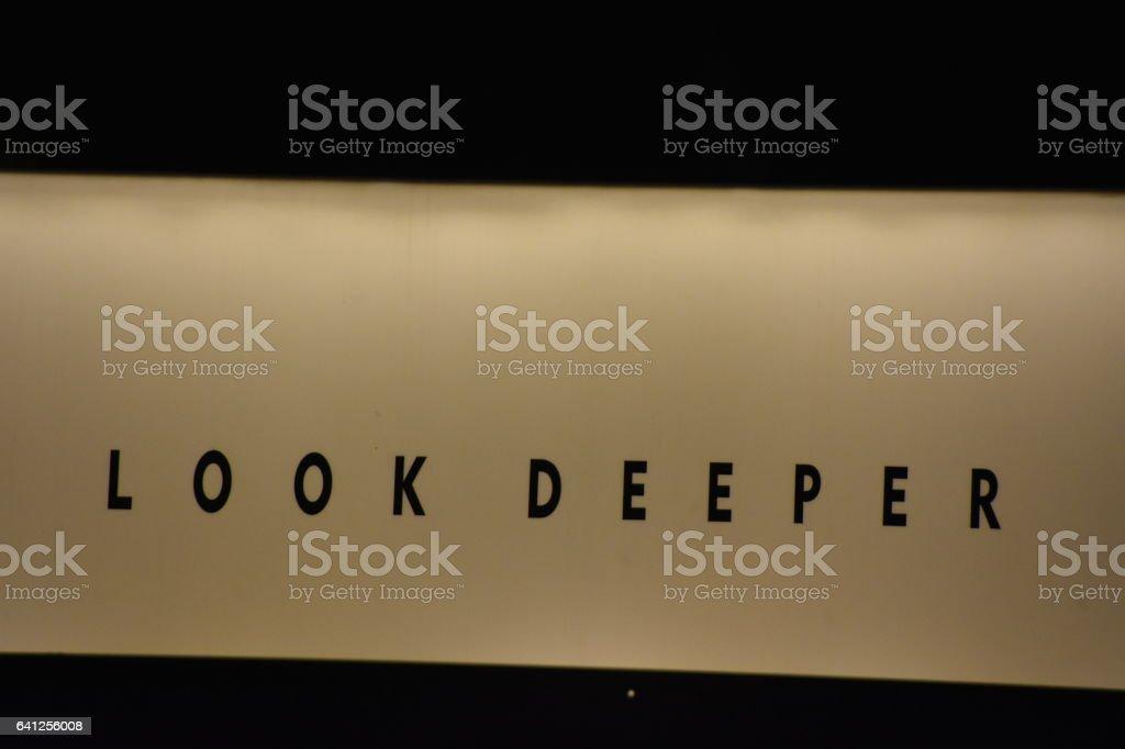 Look deeper sign stock photo