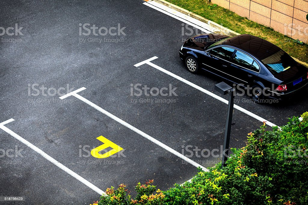 Look down empty parking spot stock photo