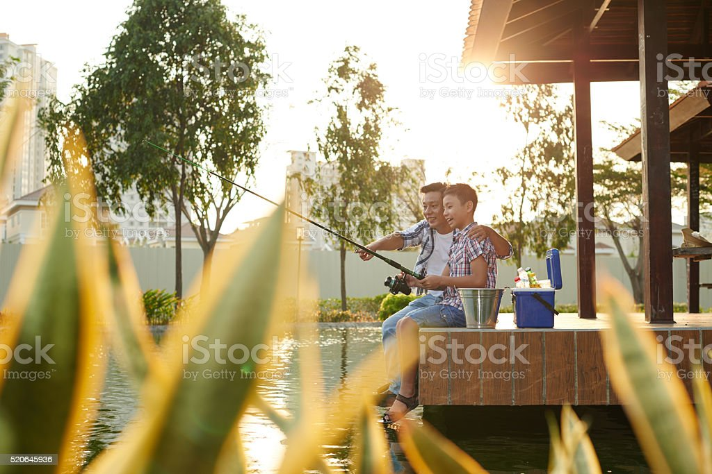Look, fish is biting stock photo