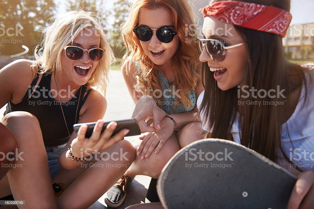 Look for new trick on skateboard stock photo