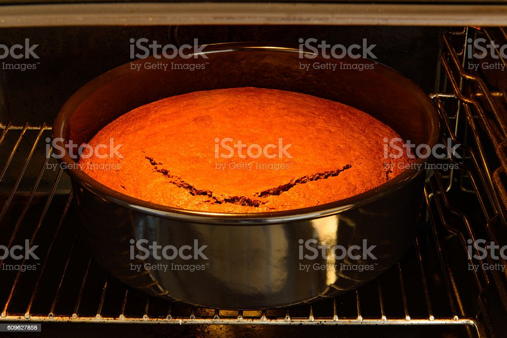 Look inside baking oven brown chocolate cake done stock photo