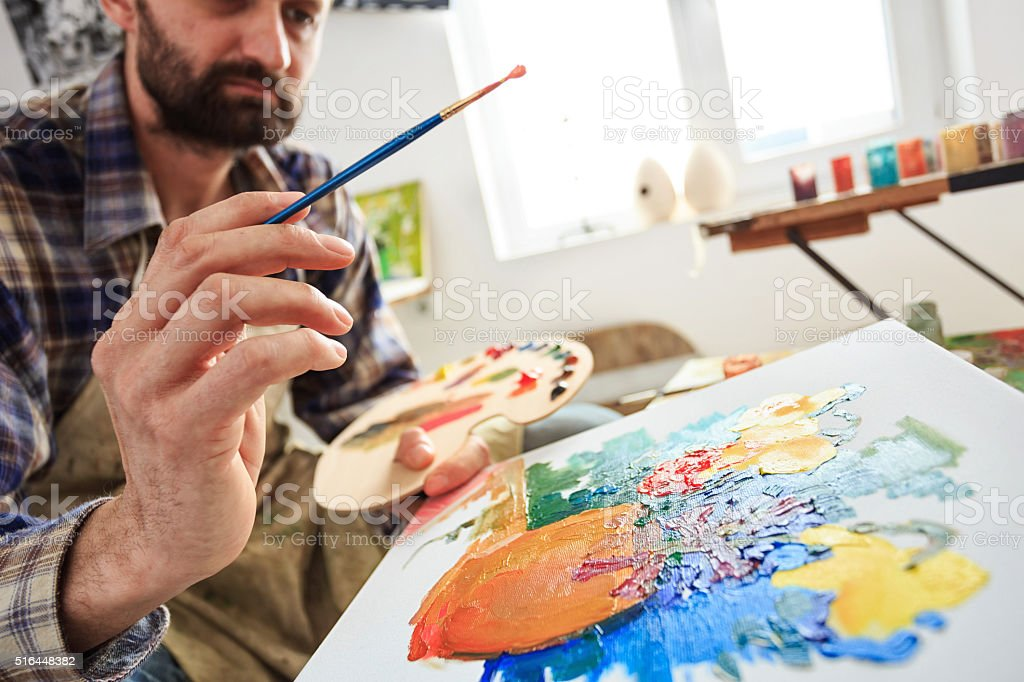 Look on the fine artist creation-side view stock photo