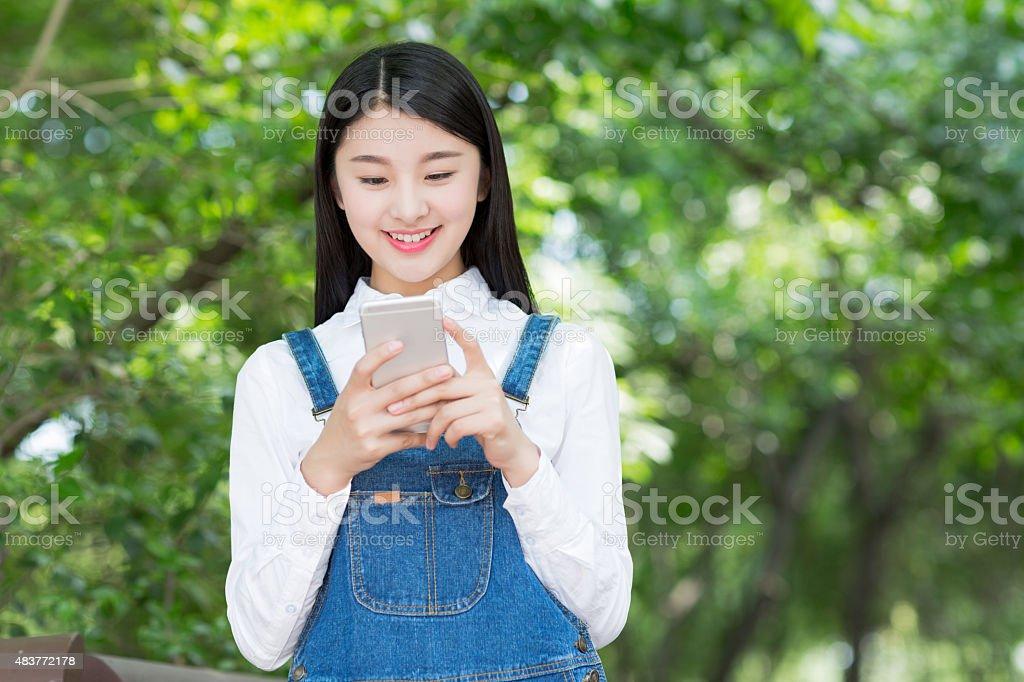 look phone girl stock photo