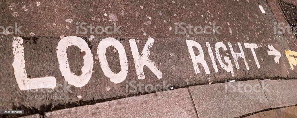 Look right writing on the street Lizenzfreies stock-foto