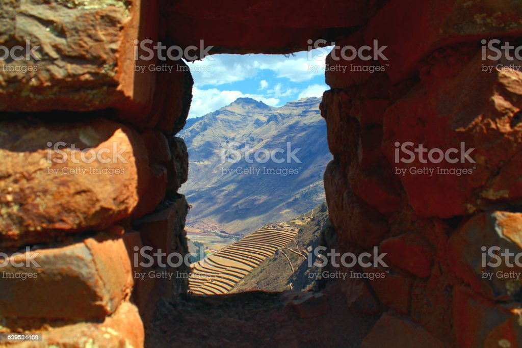 look through a window at the ruins terraces of pisac stock photo