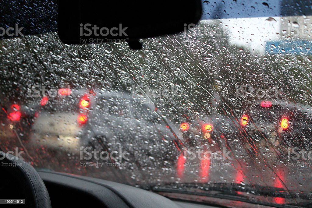 Look through drops on windshield at traffic jam in city stock photo