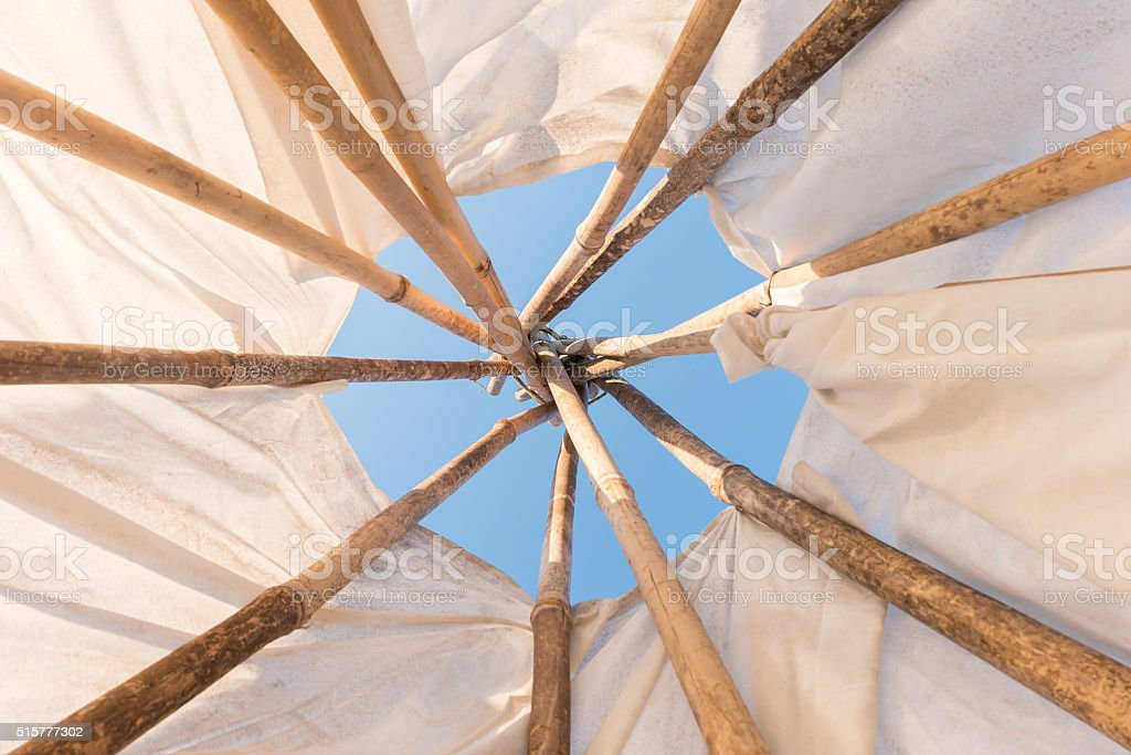 Look up in sky inside a Native American Indian tepee. stock photo