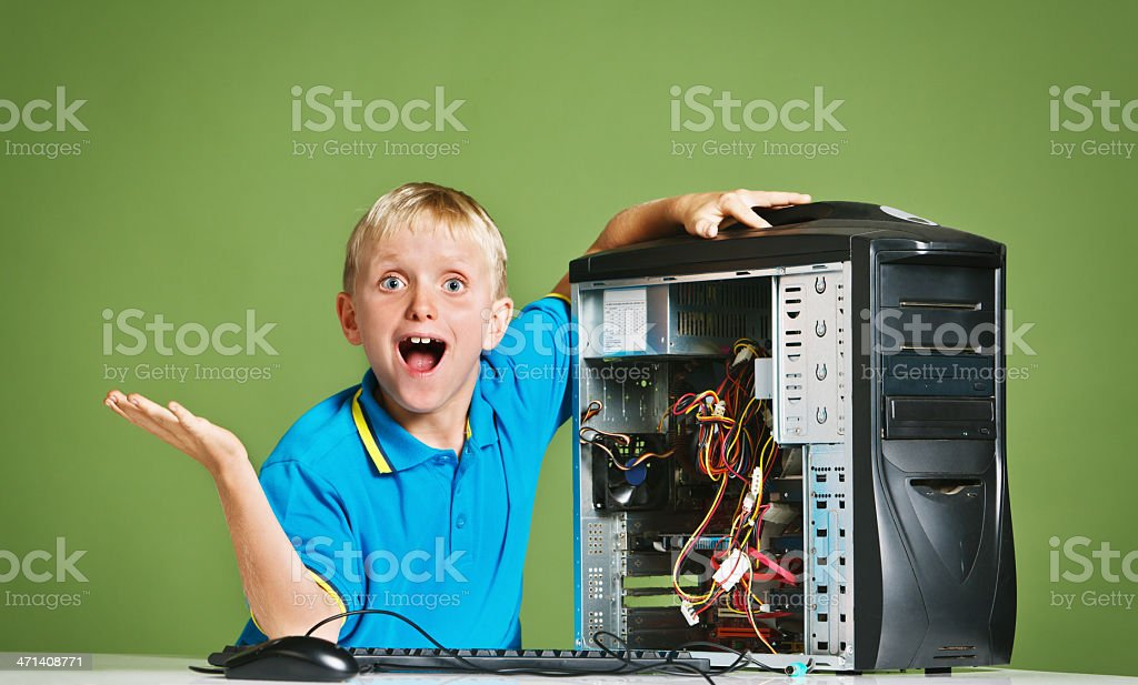 Look what I did! 9-year-old wannabe computer technician stock photo