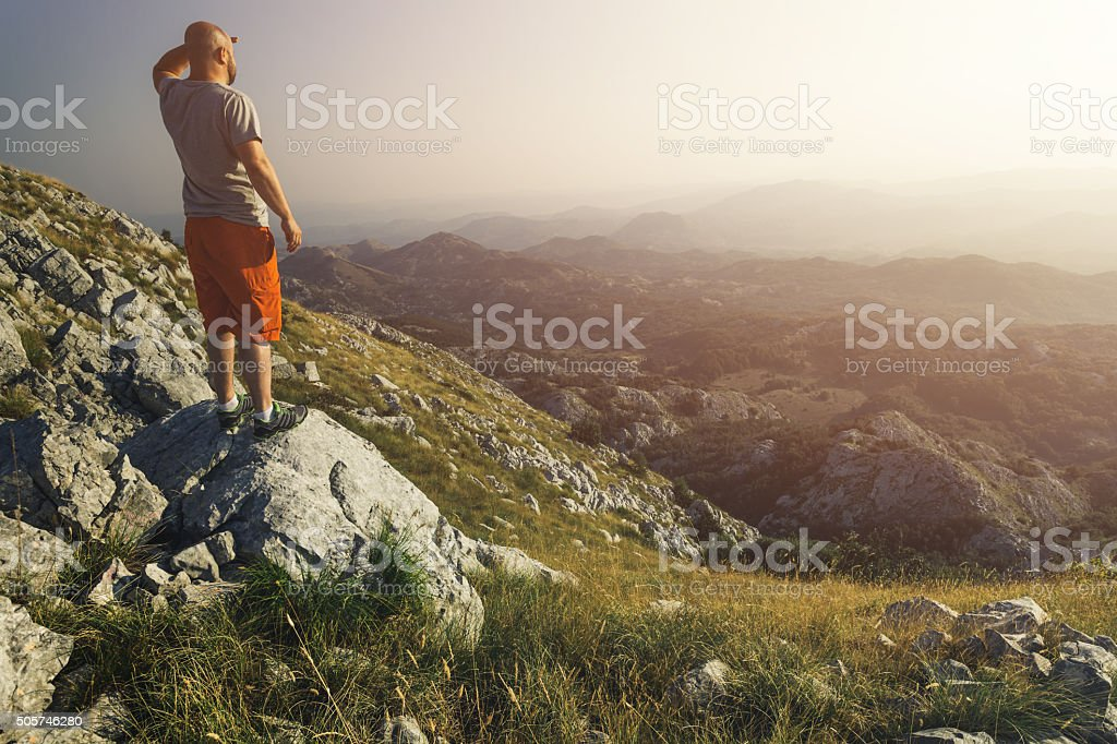 Looking ahead from top of the mountain stock photo