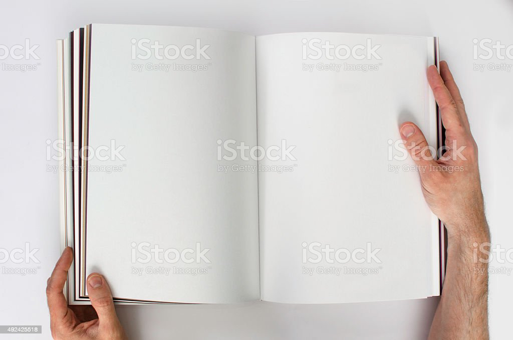 Looking at a blank book stock photo