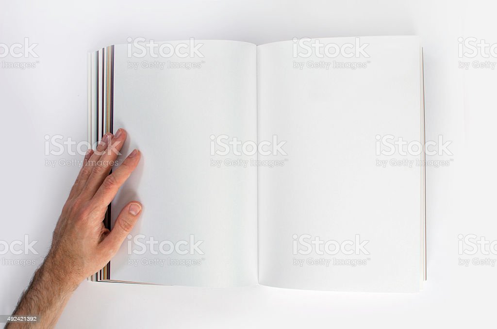 Looking at a blank book with copy space from above stock photo