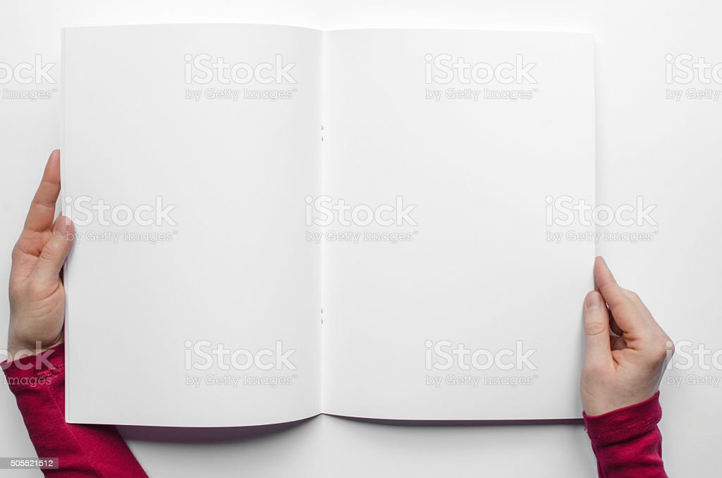 Looking at a blank brochure from above stock photo