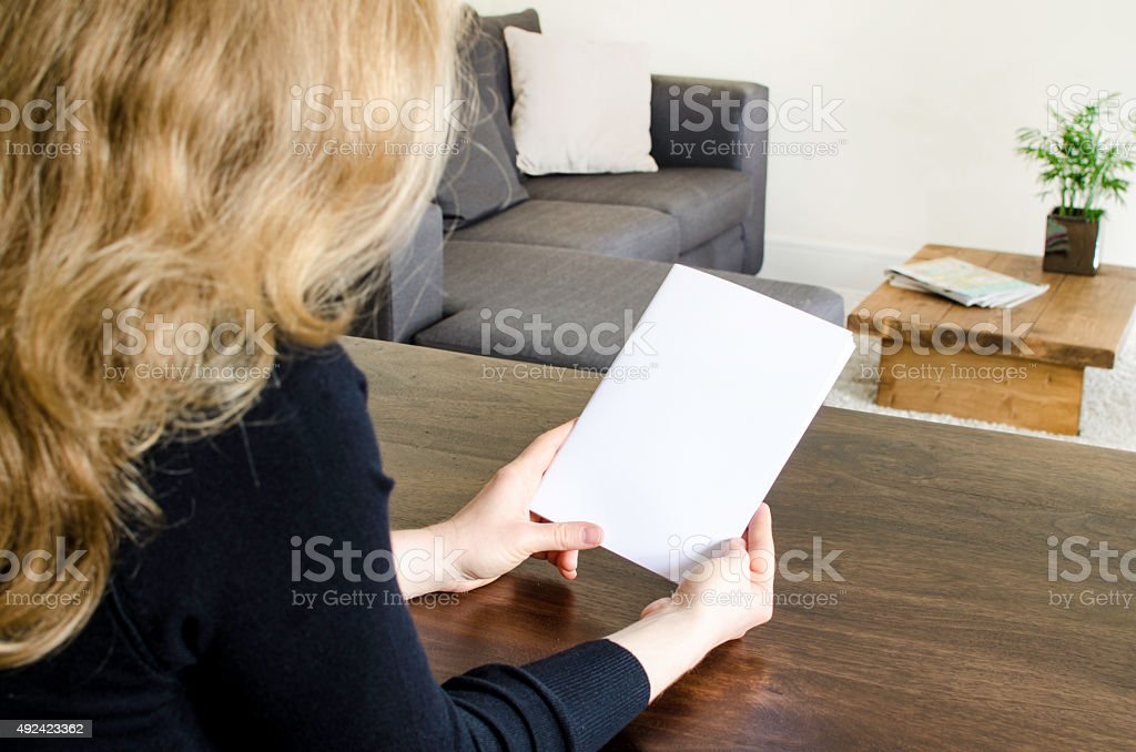Looking at a blank brochure stock photo