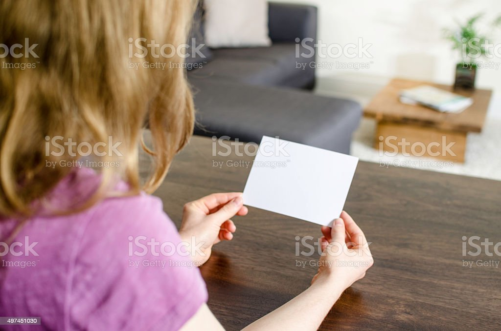 Looking at a business card or flyer stock photo