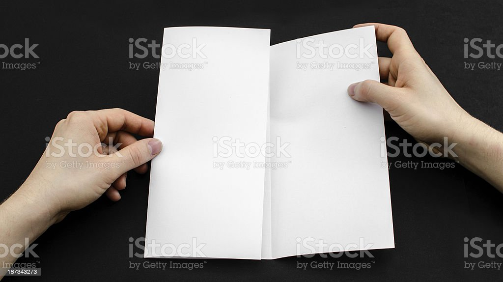 Looking at a flyer royalty-free stock photo