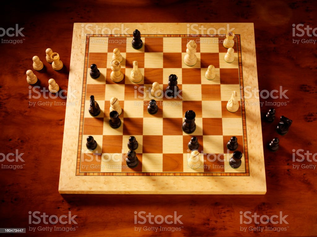 Looking at a Game of Chess royalty-free stock photo