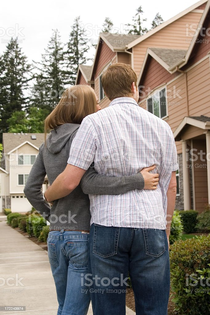 looking at a home, cute, attractive, royalty-free stock photo