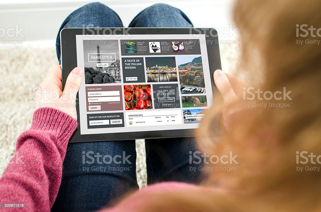 Looking at a internet webpage on a digital tablet computer stock photo