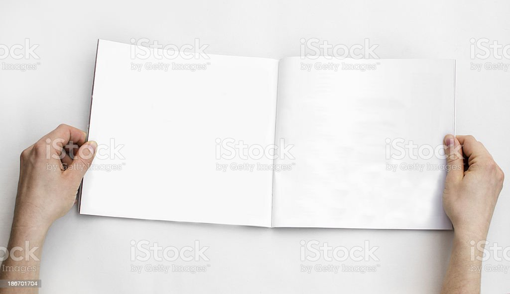 Looking at a magazine royalty-free stock photo