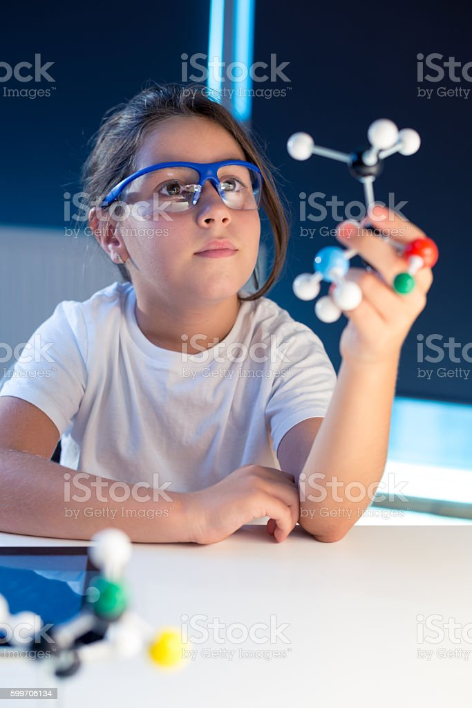 Looking at a molecular structure model stock photo