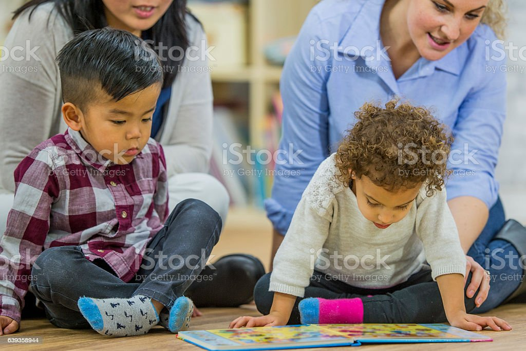 Looking at a Picture Book stock photo