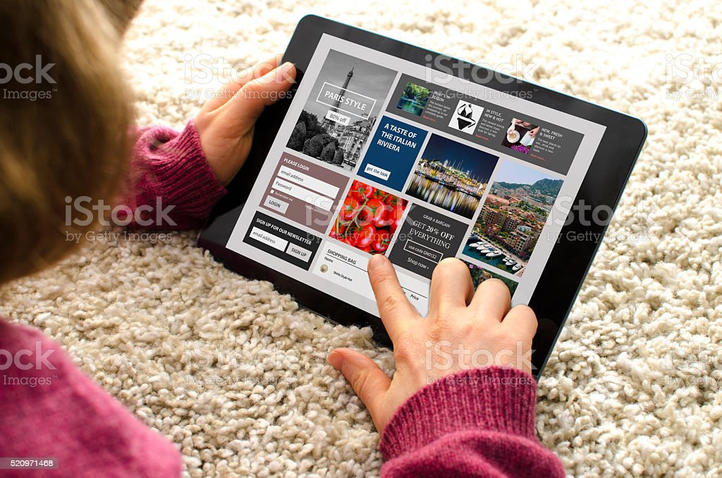 Looking at a website on a digital tablet computer stock photo