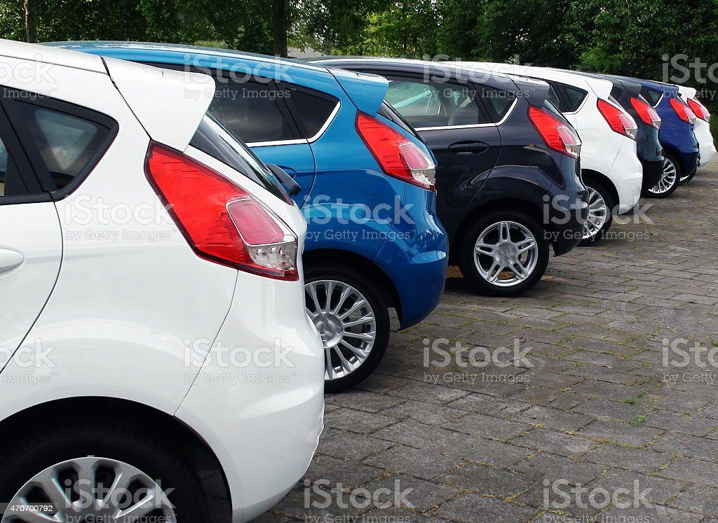 Looking at brand new cars stock photo
