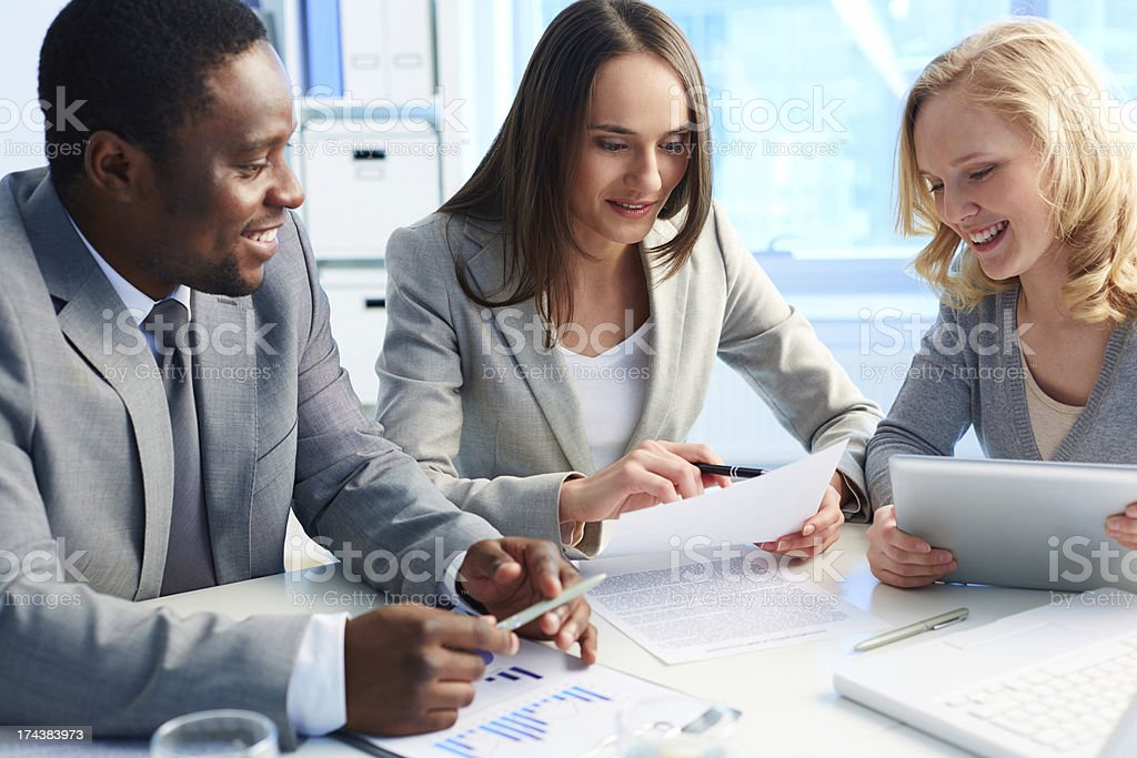 Looking at business plan stock photo