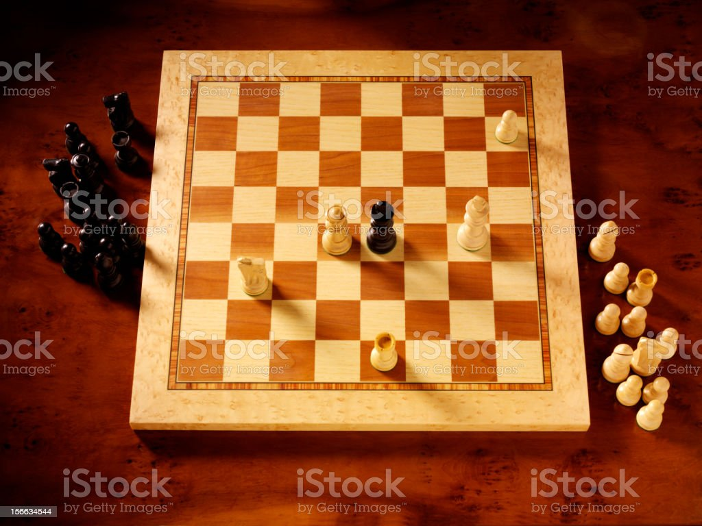 Looking at chess stock photo
