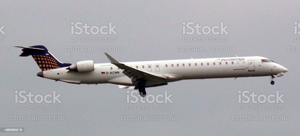 Looking At Eurowings Canadair Airplane Descending For Landing At Schiphol stock photo