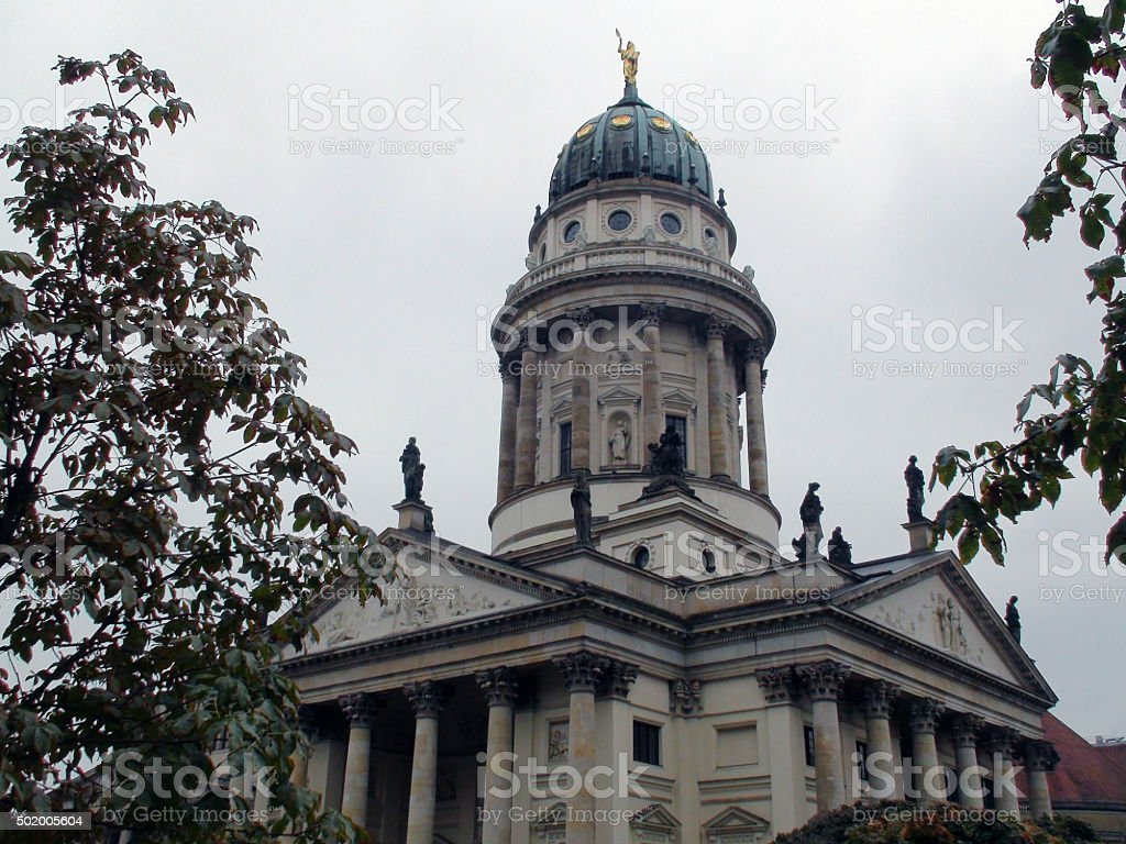 Looking At Famous French Cathedral At Gendarmenmarkt Berlin Germany Europe stock photo
