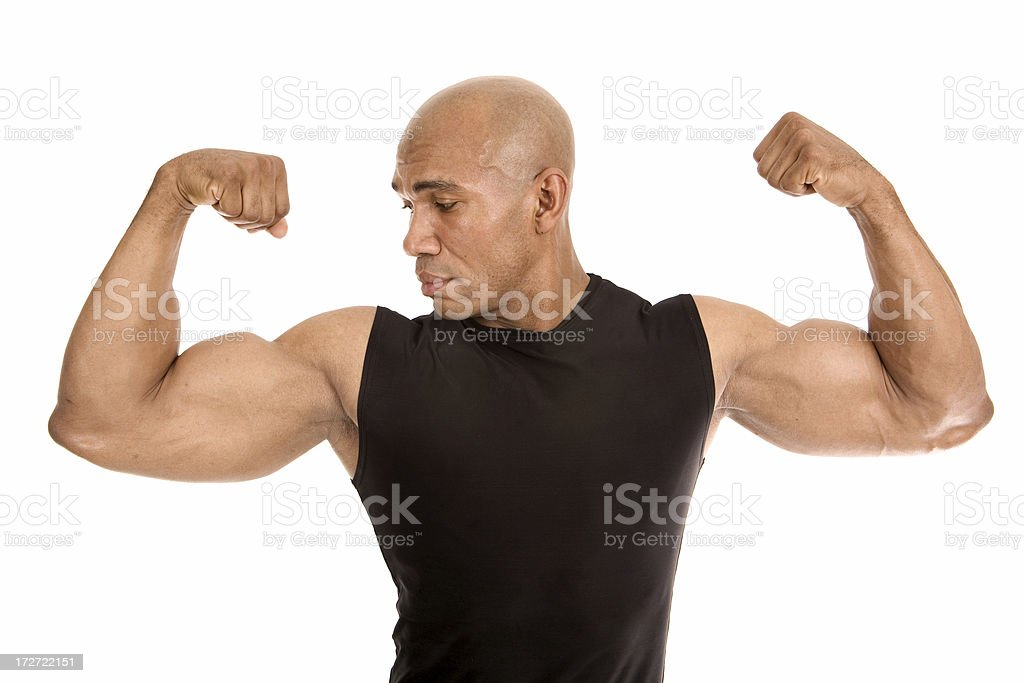 Looking at his Muscle royalty-free stock photo