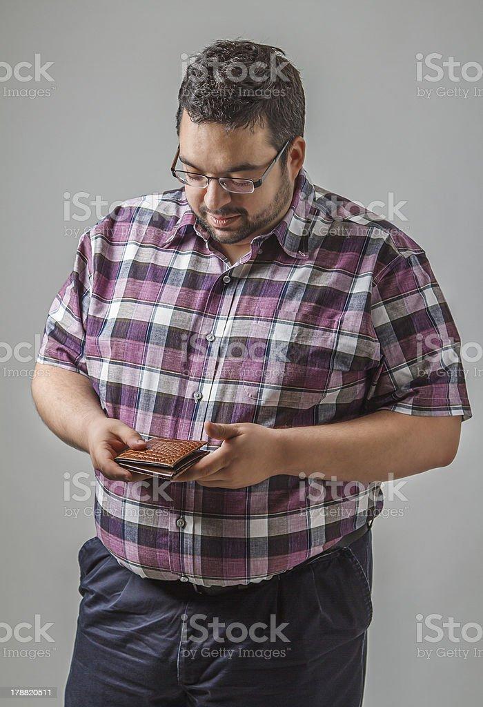 Looking at his wallet royalty-free stock photo