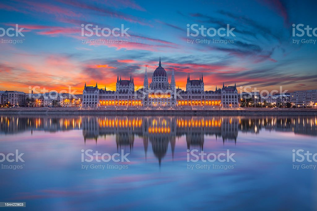 Looking at Hungarian parliament from across water at night stock photo