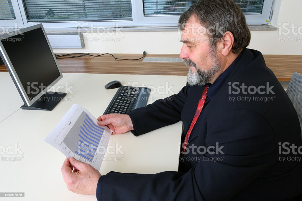Looking at income graph royalty-free stock photo