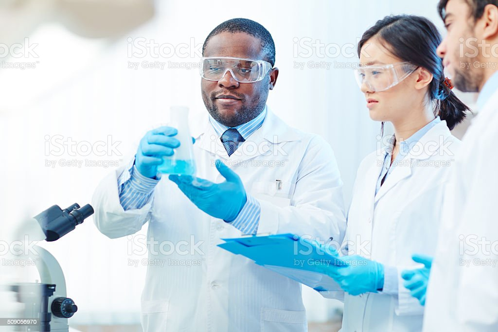 Looking at liquid substance stock photo