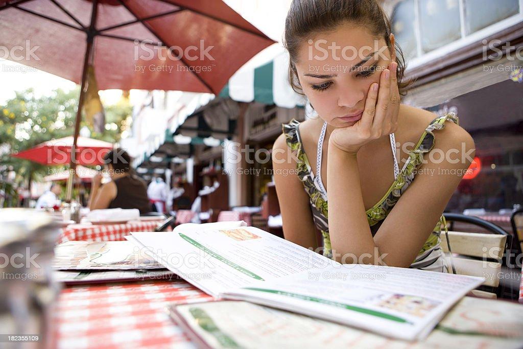 Looking at menu stock photo