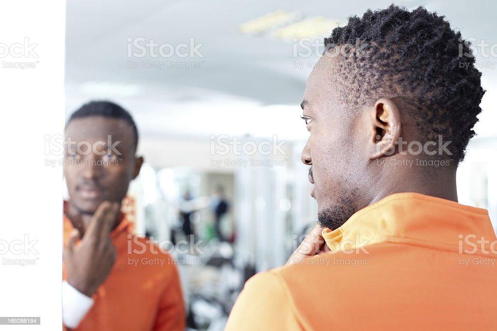 Looking at mirror stock photo
