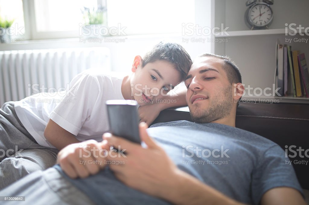 Looking at mobile phone stock photo