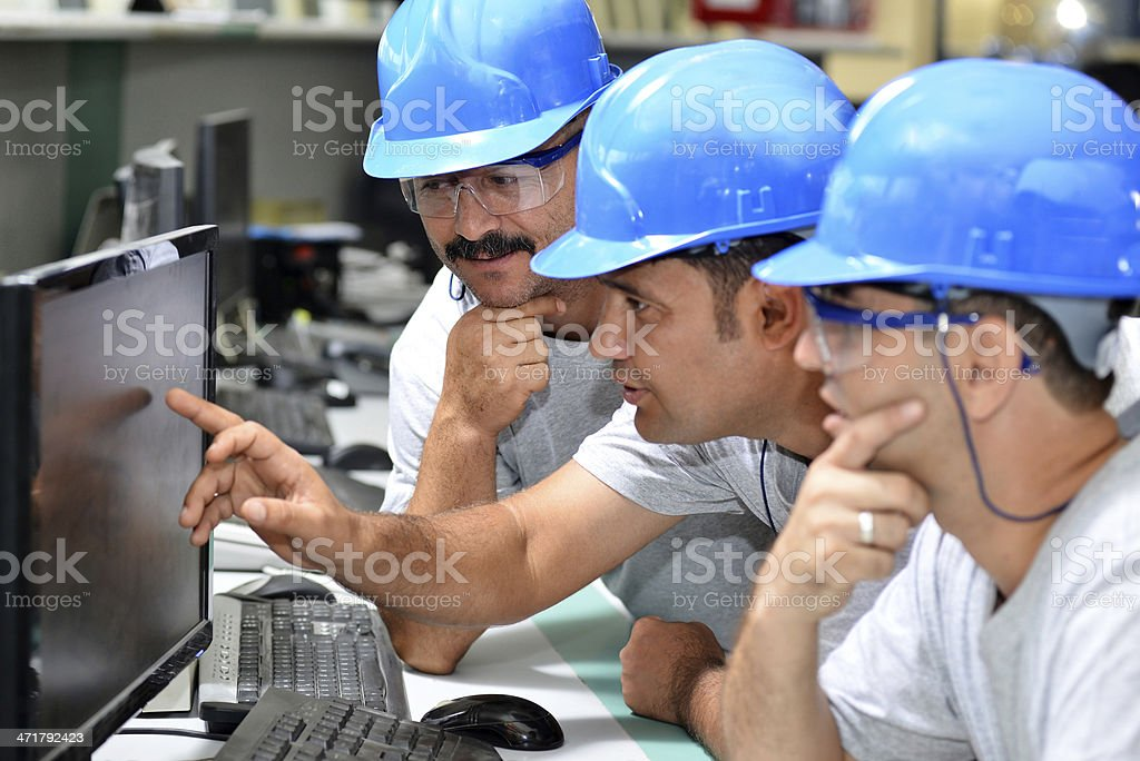 Looking at monitor stock photo