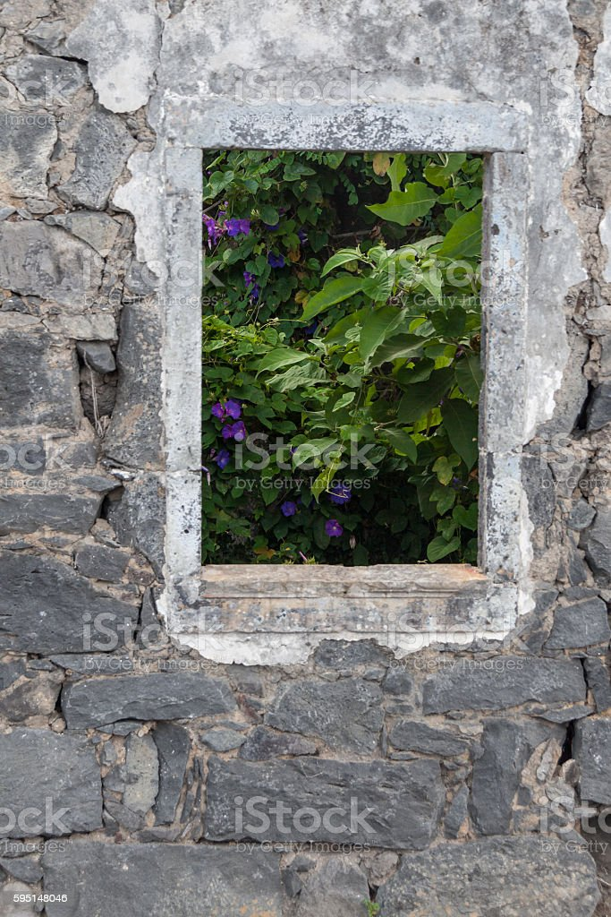 Looking at Morning Glories though window of Ruin stock photo