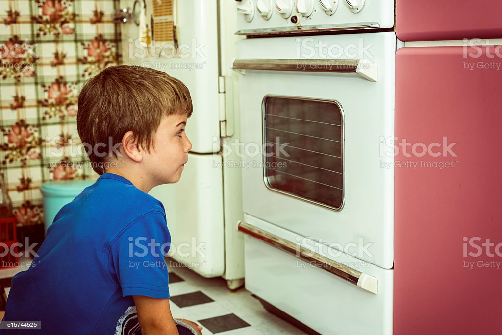 looking at oven stock photo
