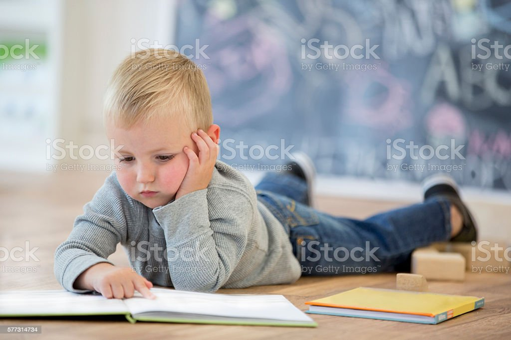 Looking at Picture Books stock photo