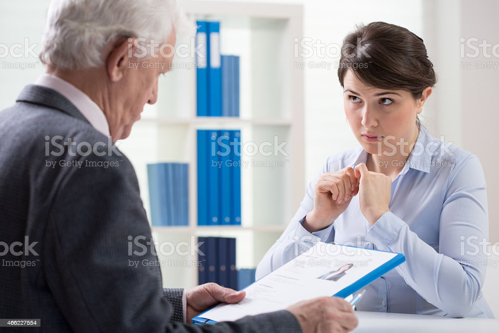 Looking at resume stock photo