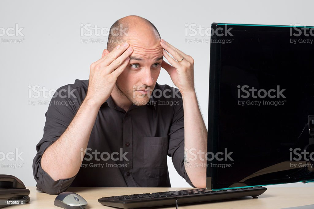 Looking at screen in disbelief stock photo