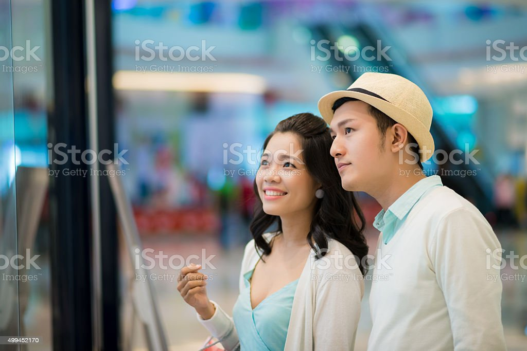 Looking at showcase stock photo