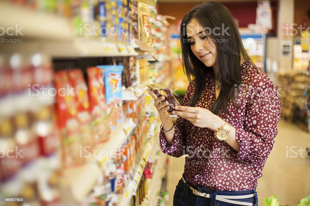 Looking at the food label stock photo